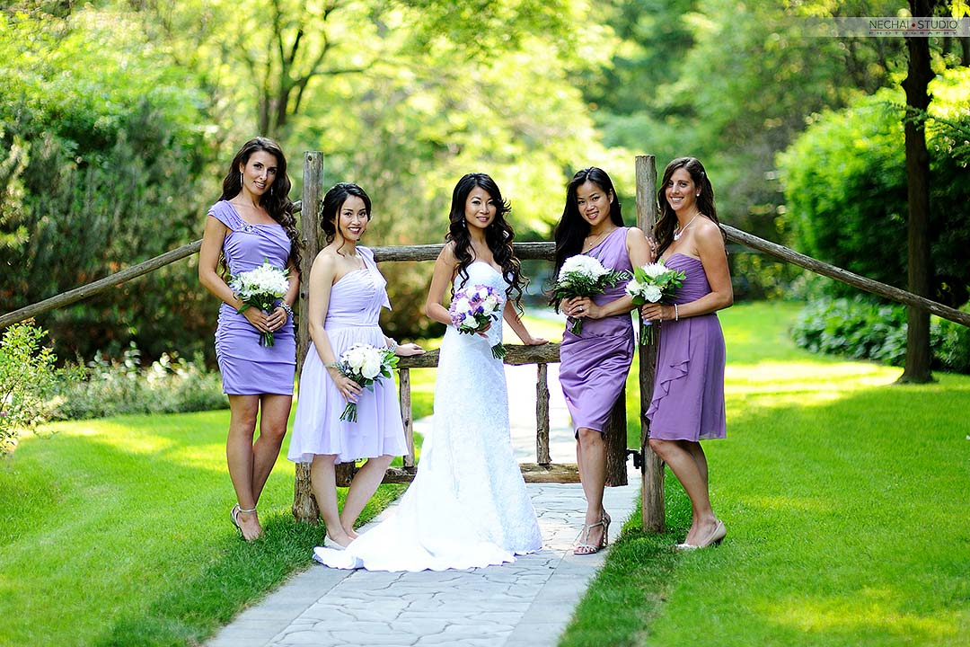 After-Bride with bridesmaids in purple dresses retouched photos